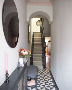 Newly renovated grey hallway with dark woodwork featuring a modern spin on traditional Victorian hallway tiles and a vintage Czech light pendant. Plus, check out our pink coving! . #frenchgrey #hallwayideas #narrowhallwaydecorating #tiles #pinkandgrey #greyinterior #hallway #entrance