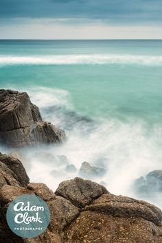 Long exposure shot of waves crashing over the rocks at Porthcurno, Cornwall. Image by Adam Clark Photography.