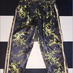NWOT O-Mighty Wang Fei Trackiez Wang Fei Trackiez from omweekend/o-mighty. Took off tags but ended up never wearing them. Satin look oriental pattern track pants with stripes on the side. Super cute!!! UNIF Pants Track Pants & Joggers