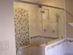 Manassas Shower Remodel: interesting to use all clear glass/plexiglass and short wall than the glass blocks; pull open door