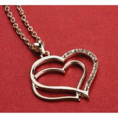 Really like this little double heart pendant.  :)