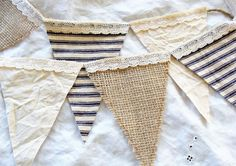 French Country Cottage Burlap Lace Ticking Flag Banner by ShabbySoul on Etsy --- Provencal Farmhouse Chic Bunting - A mix of burlap, lace, ticking and canvas make up this unique banner- Flags are sewn to twine with a 12 tail on each end for hanging. Vintage lace trim adds a soft touch to the top of each flag. To prevent fraying the burlap flags have been machine sewn on all three sides - 10 flags measuring approx. 3.5 X 5 - length of bunting is approx. 3 + 12 tail on each end