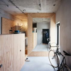 Unfinished plywood and cement smeared over concrete give a renovated Tokyo apartment the appearance of an elegant building site.