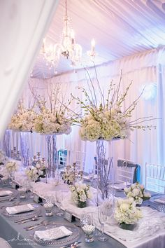 White and blue wedding with chandelier - How fantastic and luxurious is this white and blue glam setup from Grand Event Rentals.  The florals in this vignette are from Rented Elegance