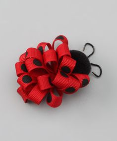 This pretty clip takes colorful ribbon and forms it into a piece of ladybug fun. Built with an alligator clip, it slides into locks and doesn't fall off.