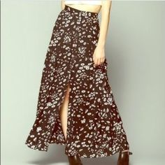 floral maxi skirt perfect condition. has buttons and a slit on the left leg Urban Outfitters Skirts Maxi