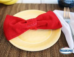 Dress up your place setting with this creative DIY bowtie napkin fold. Cute and perfect for all occasions!