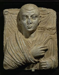 ANTIQUITIES ORIENTAL: PALMYRA SCULPTURE 1ST-3RD CE Man with shaved head. Relief bust. White limestone (2nd quarter 3rd CE) from Palmyra, Syria.  National Museum, Damascus, Syria