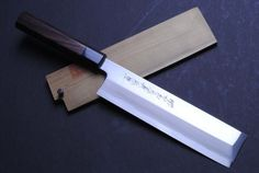 "YOSHIHIRO- Blue Steel Edo Hongasumi Usuba Vegetable Chef Knife 7.7"" 195mm Shitan Handle MADE IN JAPAN . $264.99. Blade: Single-Edged/ Blade Length: 7.7"" (195mm). Grade: Hongasumi / Knife Type: Usuba Vegetable Knife (Edo Type). Steel Type: Shiroko High-Carbon Steel. Hardness Rockwell C scale: 62-63. BOLSTER: Shitan(rose wood) / Handle Material:Shitan(rose wood). Hongasumi knives are high-grade Kasumi knives. The materials are higherquality and more attention is given dur..."