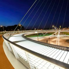 The Hovenring, in the Dutch city of Eindhoven, is a cable-stayed circular bridge for cyclists and pedestrians, and the first of its kind in the world. The 72m diameter bridge is suspended from a single 70m pylon located at the center of the roundabout by 24 cables, and appear to float over a large new junction for motorized traffic. At night the slender bike ring is lit from below to further enhance that floating effect.