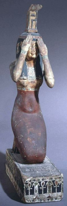 Statue of the Goddess Nephthys posed in mourning.Early Ptolemaic Period 300 B.C.