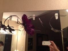 Command hooks at the top of the mirror to hang headbands