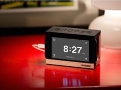 iPhone dock clock by Distil Union, discovered by The Grommet. The perfect accessory for those who like to snooze. At your bedside, the dock creates a home for your iPhone and cable, keeping things neat and tidy. Complete with a slap-happy snooze bar.