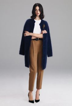Lyn Devon F/W 2012; mustard and navy make a great Autumn color scheme. I love the brooch and the texture of the coat.