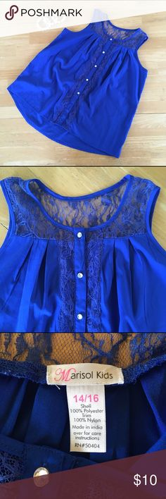 """Marisol Kids Sleeveless Blouse Blue Size 14/16 Description: Royal blue sleeveless, button up blouse with lace shoulders and embellishments. Pleated back. Bottom button is missing.  Size: 14/16 Measurements: * Length - 24"""" * Armpit to armpit - 18"""" Brand: Marisol kids Material: Polyester and nylon. Condition: Great condition. Probably never worn. Bottom button is missing. Marisol Kids Shirts & Tops Blouses"""