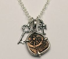sterling silver necklace with authentic widow mite coin, silver cross, & silver key. $85.00, via Etsy.