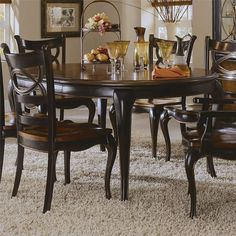 Preston Ridge Round Leg Dining Table In Black And Cherry