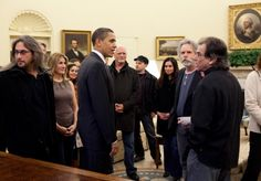 President Barack Obama meets with members of the Grateful Dead and their family members inside the Oval Office on April 13, 2009.
