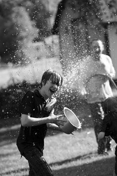 Water war... awesome photo. | Childhood | Play | Fun | No worries | Carefree | Happiness | Simple joy |