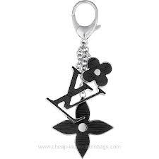 Coordinating with Louis Vuitton's famous Epi collection, this elegant bag charm features the LV logo and Monogram flowers in richly colored resin, which is grained in reference to Epi leather.--here's the bag charm I got on my black never full Louis Vuitton Key Ring, Louis Vuitton Usa, Louis Vuitton Twist, Louis Vuitton Handbags, Vuitton Bag, Leather Accessories, Handbag Accessories, Leather Jewelry, Dior Nail Polish