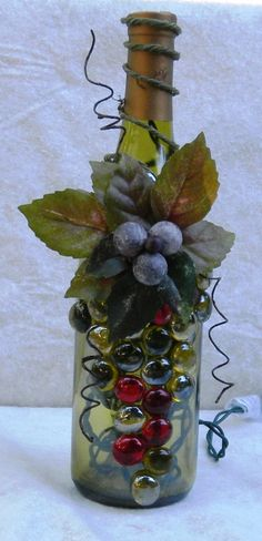 Light Green Wine Bottle Light embellished with Glass Gems, Leaves, and Berries(Bottle Painting With Lights) Painted Wine Bottles, Lighted Wine Bottles, Bottle Lights, Glass Bottles, Decorated Bottles, Wine Bottle Corks, Wine Bottle Crafts, Beer Bottles, Wine Bottle Design