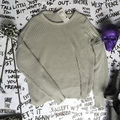Brandy Melville sweater ✖️ NEW WITH TAGS  ✖️                                        all clothing is either NWT or has been washed + sanitized, then kept in a PET FREE and SMOKE FREE environment .  too expensive , gonna break da bank ? Then add me to a  b u n d l e  or use the offer button     n o  l o w  b a l l i n g  REASONABLE offers accepted . Do NOT use offer button for requests like 40% below asking price .      N O T R A D E S   Brandy Melville Sweaters Crew & Scoop Necks
