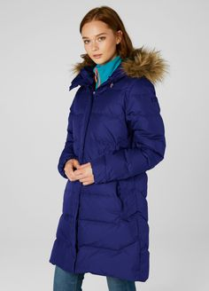 A long, feminine down filled parka to keep you warm and comfortable is an essential when the cold sets in. Featuring Allied down fill for that. Mens Winter Coat, Winter Jackets, Winter Coats, Fur Vest Outfits, Down Parka, Faux Fur Vests, Helly Hansen, Warm And Cozy, Canada Goose Jackets