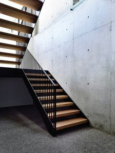 """The mural on the striking concrete form of the Wolseley House by McKimm invites you to """"linger longer,"""" and once inside you understand why you might want to stay awhile. Concrete Stairs, Concrete Forms, Roof Cladding, Timber Gates, Modern Entrance, Alfresco Area, Edwardian House, Staircase Design, Stairways"""