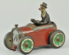 ARCADE ANDY GUMP CAR  Cast iron, familiar whimsical auto with painted Andy at wheel, painted in red and silver grille and disc wheels
