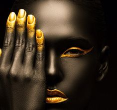 all gold, abstract, minimal makeup with heavy contrast and hyper-smooth/unreal edited skin