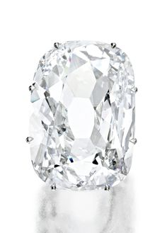AN EXCEPTIONALLY RARE DIAMOND RING.   The old mine cushion-shaped diamond weighing 33.03 carats, mounted in platinum