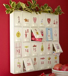 Turn a wooden cabinet into a surprise-filled Advent calendar by embellishing each door with rub-on numbers and designs from the scrapbooking aisles. Advent Activity Suggestion: Craft the ultimate holiday playlist. Christmas Activities, Christmas Projects, Christmas Traditions, Holiday Crafts, Holiday Fun, Favorite Holiday, Festive, Christmas Calendar, Noel Christmas