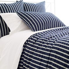 This cotton duvet is all about classic looks with textural appeal. Featuring indigo-and-white stripes and subtle smocking, it blends seamlessly with most decorating styles and works equally well in his room or in hers. Coordinate with any of our C3 bedding or accessories, including bath towels, storage bins, and cozy throws.  • 100% cotton.  • Knife edge.  • Hidden button closure.