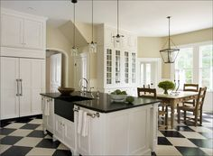 A bold diagonal black and white checkered tile floor makes a big statement in this white kitchen. Description from cococozy.com. I searched for this on bing.com/images