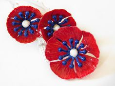 Vintage Enamel Flower Brooch Red Poppies with Blue and white center, Bright Petals Bright Color 1960s , Collectible Flower Jewelry by papercherries on Etsy https://www.etsy.com/listing/272309460/vintage-enamel-flower-brooch-red-poppies