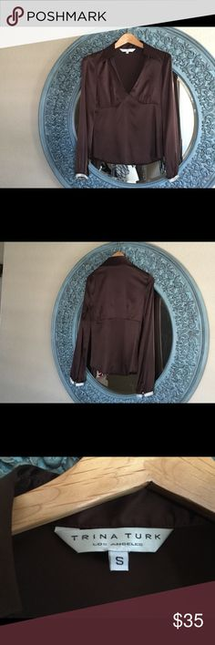 Trina Turk, silk/spandex, chocolate brown blouse. Trina Turk, long sleeve blouse with rhinestone band and button around cuff. Size S, but fits more like an XS. Beautiful chocolate brown color. Deep V front. Very comfortable, as the spandex let's the fabric stretch and move. Trina Turk Tops Blouses