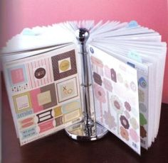 A paper towel holder with ring binders and sheet protectors. Could be used for crafting, home management, bills/office space, or kid's artwork!