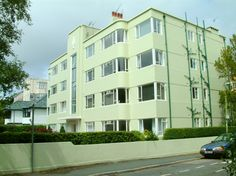 A block of flats or apartments with original windows, in a leafy road behind Bournemouth's East Cliff.