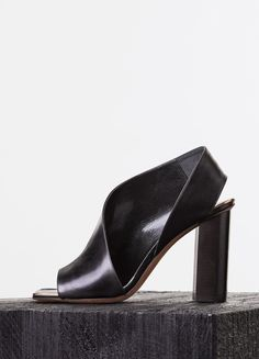 Céline Black Leather Straight Heel Asymmetrical Sandals for the Modern Gladtiator