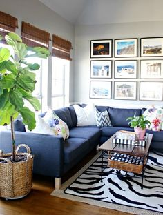 Love the mixture of bohemian and modern style in this living room décor! Designing your home can be simple: add your favorite patterns and prints and hang photographs of your travels as art!