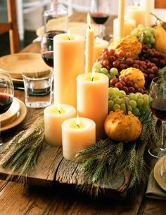 An old raised wooden slab loaded with candles and gifts of nature :)