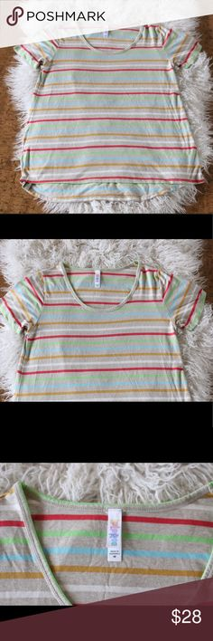 "LuLaroe Classic Tee Shirt Stripes High Low Spring LuLaroe classic t shirt.  Size medium.  94% rayon, 6% spandex.  Machine wash, hang dry.  Adorable striped pattern.  In good, preowned condition.  Measures 18"" pit to pit, 28.5"" shoulder to hem.  No trades, offers welcome. LuLaRoe Tops Tees - Long Sleeve"