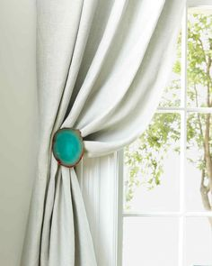 """The hardware that holds back your curtains is utilitarian, but it doesn't have to be predictable. Start with unembellished tieback hardware, and customize it however you like.Resources: Pedra agate coasters, 4 1/2"""", in Grass, rablabs.com. Contemporary round drapery holdback, in Brushed Nickel, by Design Elements Drapery Hardware, from lifestyleshomedecor.com."""