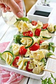 Marinated Zucchini & Tortellini Skewers is part of Simple appetizers Skewers - Marinated Zucchini & Tortellini Skewers! Looking for an easy appetizer to serve at a party or bring to a gathering These incredibly simple skewers are it! Skewer Appetizers, Appetizers For Party, Appetizer Recipes, Simple Appetizers, Recipes Dinner, Antipasto, Vegetarian Recipes, Cooking Recipes, Healthy Recipes