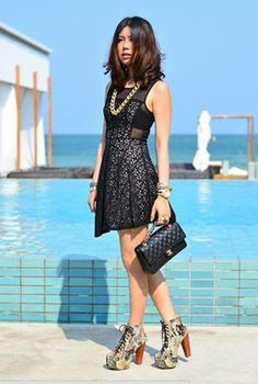 $79 OMG! Love the look.  The necklace enhances the dress and the bag is sensational.