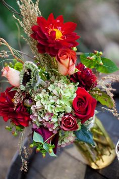 ** Suzie **  rustic flower arrangement    <3 <3    I love the different variety of flowers. Maybe with more of my colors? We could work these into the centerpieces or even bridesmaids bouquets
