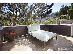 Townhouse condo in a building divided laterally versus horizontally.   $1,444,000  517  29th st, 94131