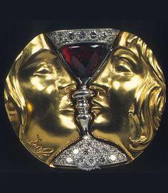 Tristan and Isolde, Salvador Dali, 1953, 18 karat yellow gold, platinum, diamonds, Almandine cabochon garnet. #Dali #retro #jewel