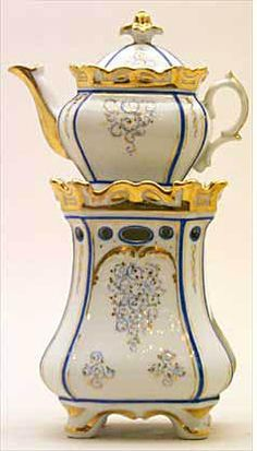 Teapot #439  Rectangular, on four feet, white background, fluted gold top to stand and conforming pot,   narrow Sevres blue line outline to panel.  Acquired in Avignon