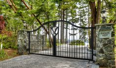 Front Entry Gates To Luxury Estate Home With Acreage On